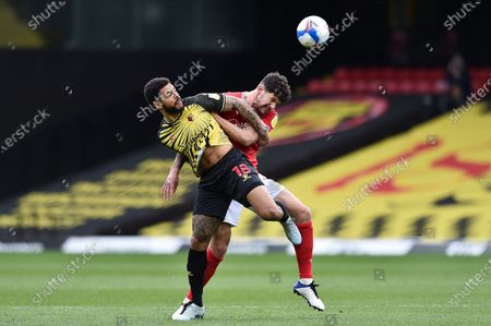 Watford forward Andre Gray (18) and Nottingham Forest Defender Tobias Figueiredo (3) battle for possession during the EFL Sky Bet Championship match between Watford and Nottingham Forest at Vicarage Road, Watford