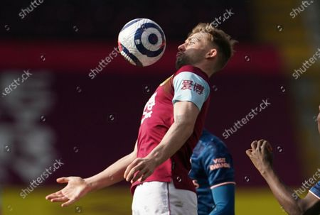 Stock Photo of Burnley's Charlie Taylor controls the ball during the English Premier League soccer match between Burnley and Arsenal at Turf Moor stadium in Burnley, England