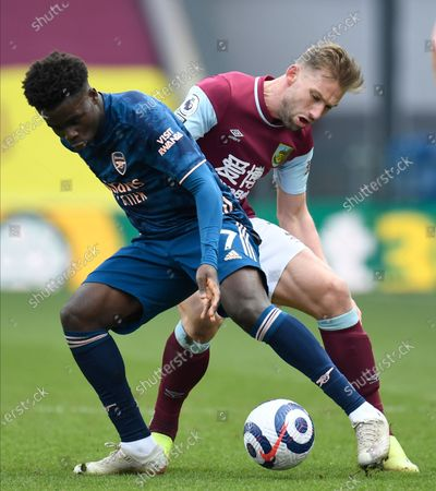 Stock Picture of Arsenal's Bukayo Saka, left, and Burnley's Charlie Taylor challenge for the ball during the English Premier League soccer match between Burnley and Arsenal at Turf Moor stadium in Burnley, England