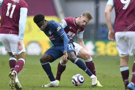 Charlie Taylor (R) of Burnley in action against Bukayo Saka (L) of Arsenal during the English Premier League soccer match between Burnley FC and Arsenal FC in Burnley, Britain, 06 March 2021.
