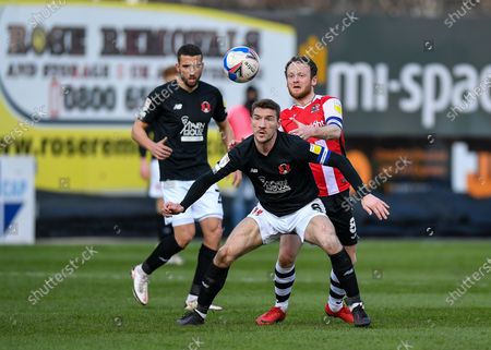 Leyton Orient Craig Clay (8) shields the ball from Jake Taylor (8) of Exeter City  during the EFL Sky Bet League 2 match between Exeter City and Leyton Orient at St James' Park, Exeter
