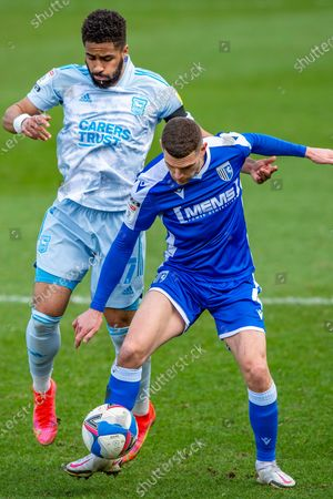 Ipswich Town forward Keanan Bennetts (17) and Gillingham FC midfielder Stuart O'Keefe (4)  during the EFL Sky Bet League 1 match between Gillingham and Ipswich Town at the MEMS Priestfield Stadium, Gillingham