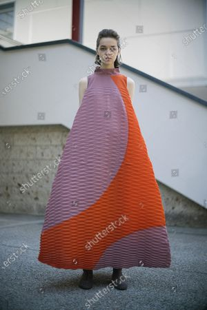 A model presents a creation by Issey Miyake during the Paris Fashion Week's Women Fall/Winter 2021-2022 ready-to-wear fashion digital show in Paris, France, on March 5, 2021.