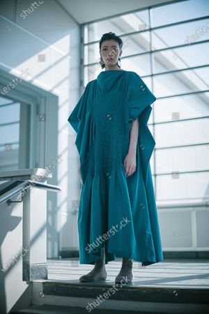 Stock Picture of A model presents a creation by Issey Miyake during the Paris Fashion Week's Women Fall/Winter 2021-2022 ready-to-wear fashion digital show in Paris, France, on March 5, 2021.