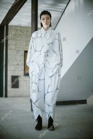 Stock Photo of A model presents a creation by Issey Miyake during the Paris Fashion Week's Women Fall/Winter 2021-2022 ready-to-wear fashion digital show in Paris, France, on March 5, 2021.