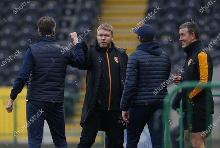 Stock Image of Hull City manager Grant McCann fist pumps Bristol Rovers manager Joey Barton and his backroom staff after the match: Craig Brough/JMP