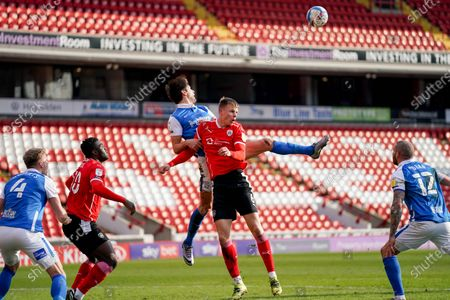Birmingham City defender George Friend (5) wrestles with Barnsley defender Mads Juel Andersen (6) during the EFL Sky Bet Championship match between Barnsley and Birmingham City at Oakwell, Barnsley