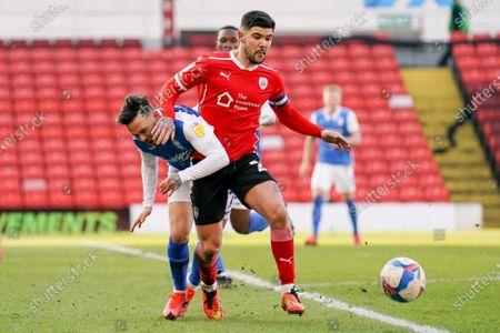 Barnsley midfielder Alex Mowatt (27) tackles Birmingham City midfielder Ivan Sanchez (17) during the EFL Sky Bet Championship match between Barnsley and Birmingham City at Oakwell, Barnsley