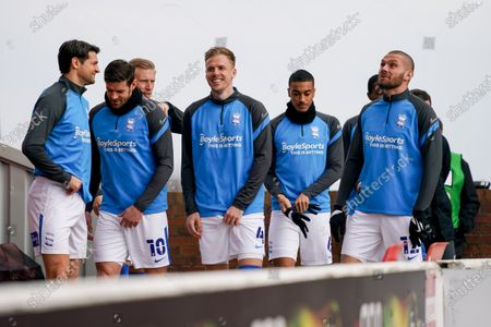 Birmingham City players, including Birmingham City defender Marc Roberts (4) and Birmingham City defender George Friend (5), gesture and react warming up during the EFL Sky Bet Championship match between Barnsley and Birmingham City at Oakwell, Barnsley