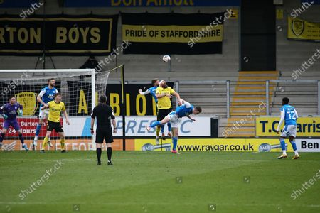 Michael Bostwick of Burton Albion (5) wins a header during the EFL Sky Bet League 1 match between Burton Albion and Peterborough United at the Pirelli Stadium, Burton upon Trent