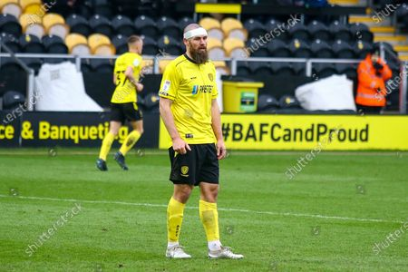 Michael Bostwick of Burton Albion (5) wearing a bandage after a clash of heads during the EFL Sky Bet League 1 match between Burton Albion and Peterborough United at the Pirelli Stadium, Burton upon Trent