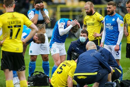 Michael Bostwick of Burton Albion (5) receives treatment for a head wound during the EFL Sky Bet League 1 match between Burton Albion and Peterborough United at the Pirelli Stadium, Burton upon Trent