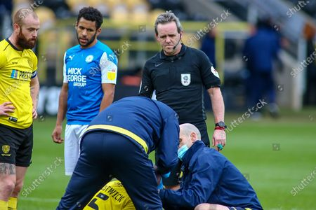 CARL BROOK Referee over sees an injury to Michael Bostwick of Burton Albion (5) during the EFL Sky Bet League 1 match between Burton Albion and Peterborough United at the Pirelli Stadium, Burton upon Trent