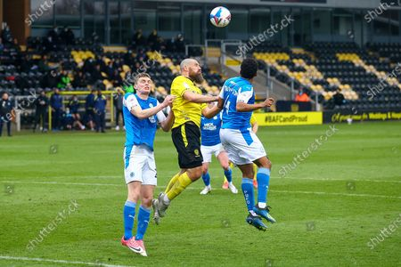 Michael Bostwick of Burton Albion (5) and Nathan Thompson of Peterborough United (4) battle for a high ball during the EFL Sky Bet League 1 match between Burton Albion and Peterborough United at the Pirelli Stadium, Burton upon Trent