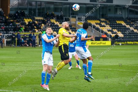 Michael Bostwick of Burton Albion (5) and Nathan Thompson of Peterborough United (4) battle for a header during the EFL Sky Bet League 1 match between Burton Albion and Peterborough United at the Pirelli Stadium, Burton upon Trent