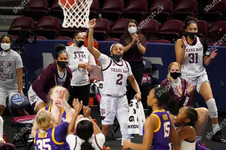 Texas A&M guard Aaliyah Wilson (2) and N'dea Jones (31) celebrate a basket during the second half of an NCAA college basketball game against LSU, during the Southeastern Conference tournament in Greenville, S.C. Texas A&M won 77-58