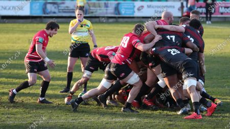 Referee Sara Cox blows her whistle to penalise Saracens in a scrum and award a penalty to Cornish Pirates
