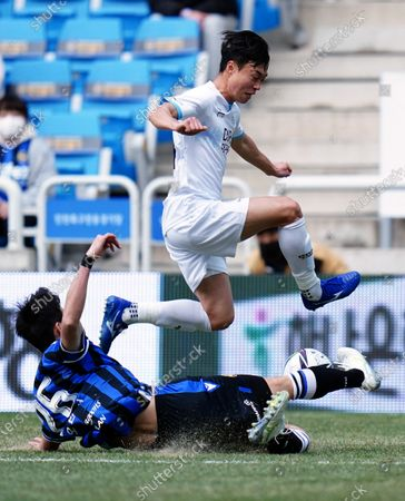 Oh Ban-suk of Incheon United makes a sliding tackle to win the ball during 2021 K League 1 match between Incheon United and Daegu FC at incheon football stadium in Incheon, South Korea, on March 06, 2021.