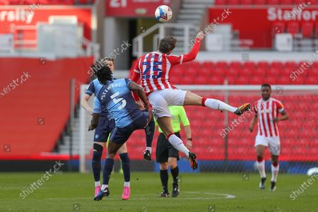 Stoke City midfielder Nick Powell (25) and Wycombe Wanderers defender Anthony Stewart (5) during the EFL Sky Bet Championship match between Stoke City and Wycombe Wanderers at the Bet365 Stadium, Stoke-on-Trent