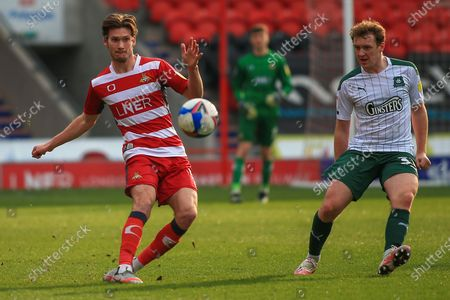 Joe Wright (5) of Doncaster Rovers clears the ball during the EFL Sky Bet League 1 match between Doncaster Rovers and Plymouth Argyle at the Keepmoat Stadium, Doncaster