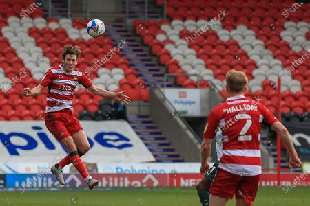 Joe Wright (5) of Doncaster Rovers heads the ball clear during the EFL Sky Bet League 1 match between Doncaster Rovers and Plymouth Argyle at the Keepmoat Stadium, Doncaster