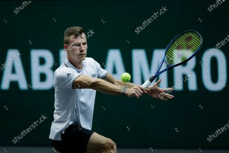 Hungary's Marton Fucsovics plays a shot against Croatia's Borna Coric in their semifinal men's singles match of the ABN AMRO world tennis tournament at Ahoy Arena in Rotterdam, Netherlands