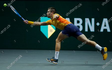 Croatia's Borna Coric plays a shot against Hungary's Marton Fucsovics in their semifinal men's singles match of the ABN AMRO world tennis tournament at Ahoy Arena in Rotterdam, Netherlands