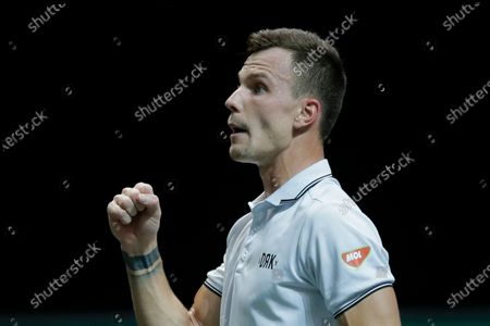 Hungary's Marton Fucsovics clenches his fist after winning the first set against Croatia's Borna Coric in their semifinal men's singles match of the ABN AMRO world tennis tournament at Ahoy Arena in Rotterdam, Netherlands