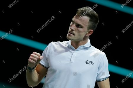 Hungary's Marton Fucsovics clenches his fist after scoring a point against Croatia's Borna Coric in their semifinal men's singles match of the ABN AMRO world tennis tournament at Ahoy Arena in Rotterdam, Netherlands