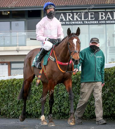 Robert Power on Santa Rossa being led in by Noel Clarke after winning The Racing Again March 13th Mares Maiden Hurdle