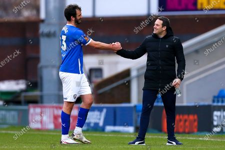 Stock Picture of Chesterfield manager James Rowe celebrates with Gavin Gunning of Chesterfield at full time