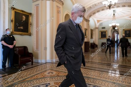 Stock Photo of Sen. Bill Cassidy, R-La., leaves the chamber just after passage of the Democrat's $1.9 trillion COVID-19 relief bill, at the Capitol in Washington, . The bill was narrowly passed, setting up final congressional approval by the House next week so lawmakers can send it to President Joe Biden for his signature