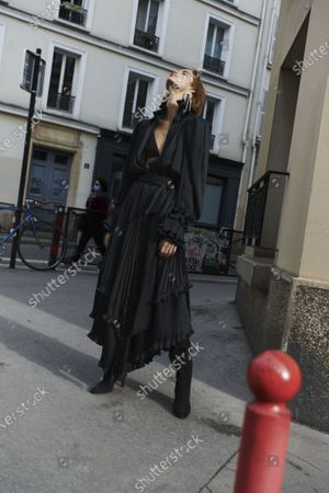 A Model wearing an outfit from the Womens Ready to wear, pret a porter, collections, winter  2021, original creation, during the Womenswear Fashion Week in Paris, from the house of Alexandre Vauthier
