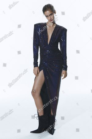 Stock Photo of A Model wearing an outfit from the Womens Ready to wear, pret a porter, collections, winter  2021, original creation, during the Womenswear Fashion Week in Paris, from the house of Alexandre Vauthier