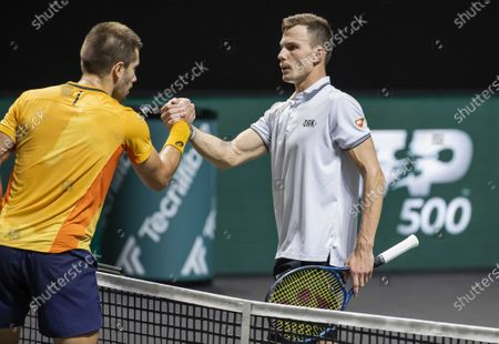 Marton Fucsovics Hungary (R) wins the semi-final against Borna Coric of Croatia on the sixth day of the ABN AMRO World Tennis Tournament in Rotterdam, Netherlands, 06 March 2021.