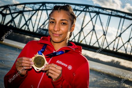 Belgian Nafissatou Nafi Thiam shows her gold medal pictured during a photoshoot after Yesterday's women pentathlon event at the European Athletics Indoor Championships, in Torun, Poland, Saturday 06 March 2021. Belgians Thiam and Vidts won the gold and silver medal.