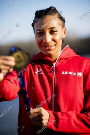 Belgian Nafissatou Nafi Thiam shows her gold medal during a photoshoot after Yesterday's women pentathlon event at the European Athletics Indoor Championships, in Torun, Poland, Saturday 06 March 2021. Belgians Thiam and Vidts won the gold and silver medal.