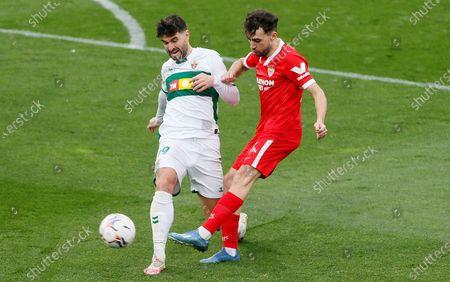 Elche's defender Antonio Barragan (L) fights for the ball against Sevilla's Sapanish-Moroccan winger Munir El Haddadi (R) during their LaLiga soccer match played Martinez Valero Stadium, in Elche, Spain, 03 March 2021.