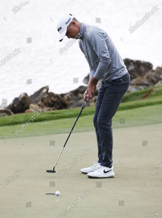 Martin Laird of Scotland putts on the eighteenth hole during the third round of the Arnold Palmer Invitational presented by Mastercard golf tournament at the Bay Hill Club & Lodge in Orlando, Florida, USA, 06 March 2021.