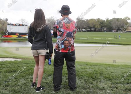 A fan wears a shirt full of Tiger Woods images near the eighth hole during the third round of the Arnold Palmer Invitational presented by Mastercard golf tournament at the Bay Hill Club & Lodge in Orlando, Florida, USA, 06 March 2021.