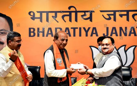"""Former TMC leader Dinesh Trivedi joins BJP in the presence of party president JP Nadda along with Minister of Railways of India, and Piyush Goyal  Minister for Petroleum & Natural Gas and Steel Dharmendra Pradhan, at BJP headquarters, on March 6, 2021 in New Delhi, India. Former Trinamool Congress MP Dinesh Trivedi joined the BJP on Saturday, weeks after he announced quitting his Rajya Sabha membership on the floor of the House deploring """"violence"""" in poll-bound West Bengal."""
