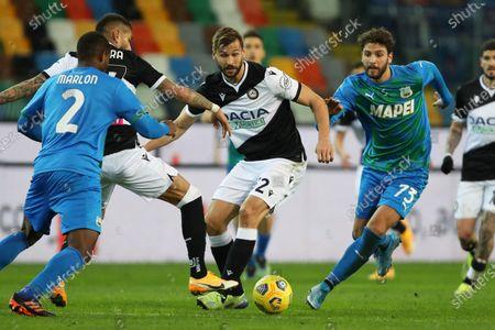Udinese's Fernando Llorente (L) and Sassuolo's Manuel Locatelli in action during the Italian Serie A soccer match Udinese Calcio vs US Sassuolo Calcio at the Friuli - Dacia Arena stadium in Udine, Italy, 6 March 2021.