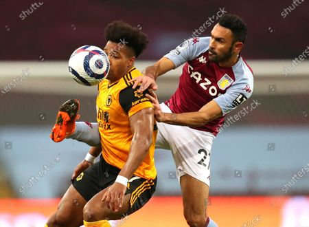 Wolverhampton Wanderers' Adama Traore, left, and Aston Villa's Ahmed Elmohamady challenge for the ball during the English Premier League soccer match between Aston Villa and Wolverhampton Wanderers at Villa Park in Birmingham, England