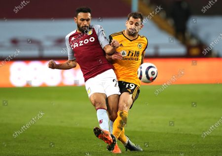 Stock Image of Aston Villa's Ahmed Elmohamady, left, and Wolverhampton Wanderers' Jonny challenge for the ball during the English Premier League soccer match between Aston Villa and Wolverhampton Wanderers at Villa Park in Birmingham, England