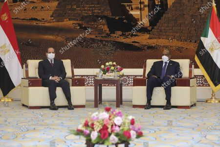 Stock Image of Egyptian President Abdel Fattah al-Sisi meets Chairman of the Sovereignty Council of Sudan Gen. Abdel Fattah Abdelrahman al-Burhan at the Presidential Palace in Khartoum, Sudan, . Egypt's presidency says President Abdel Fattah el-Sissi trip was to address an array of issues, including economic and military ties and the two nations' dispute with Ethiopia over a massive dam Addis Ababa is building on the Blue Nile. The visit comes amid a rapprochement between the two governments