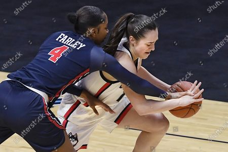 Connecticut's Nika Mühl, right, steals the ball form St. John's Raven Farley, left, during the first half of an NCAA college basketball game in the quarterfinals of the Big East Conference tournament at Mohegan Sun Arena, in Uncasville, Conn