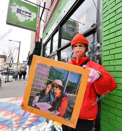 Singer/musician Ron Gallo holds his new record,'Peacemeal', in front of Repo Records on South Street in Philadelphia, PA.