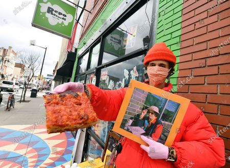 Singer/musician Ron Gallo hands out free pizza at Repo Records in Philadelphia to promote the release of his new record 'Peacemeal'.