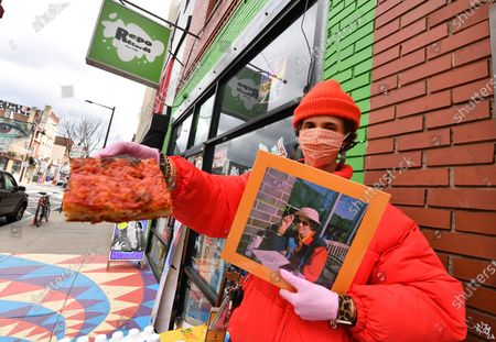 Stock Image of Singer/musician Ron Gallo hands out free pizza at Repo Records in Philadelphia to promote the release of his new record 'Peacemeal'.