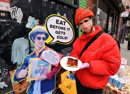 Stock Picture of Singer/musician Ron Gallo hands out free pizza at Repo Records in Philadelphia to promote the release of his new record 'Peacemeal'.